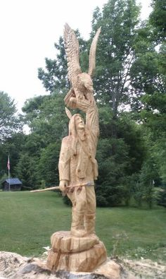 angel chainsaw carvings | chainsaw artists chainsaw art chainsaw sculptures chainsaw carvings ...
