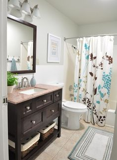 Bathroom remodel after. Vanity is from Home Depot. Wall color: Oyster Bay, Glidden
