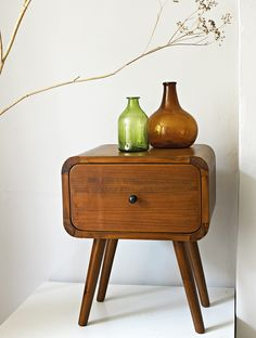 Danish teak cabinet - why did we get rid of my parents' '70s teak furniture again?  Love the bottles!