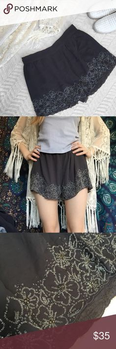 """Urban Outfitters Kimchi Blue Gray Beaded Shorts Urban Outfitters • Kimchi Blue • Size Medium • Charcoal gray, breathable fabric with a matte finish • Beaded flowers line the bottom of the shorts all the way around (sliver and bronze beads) • Elastic waistband in the back half • Scalloped edges at the bottom • Slip shorts underneath • Measurements: Waist: 14"""" straight across (but stretchy). Length: 12 3/4"""". Inseam: 2"""" • Missing two beads (at least I think they are, but they might just be…"""