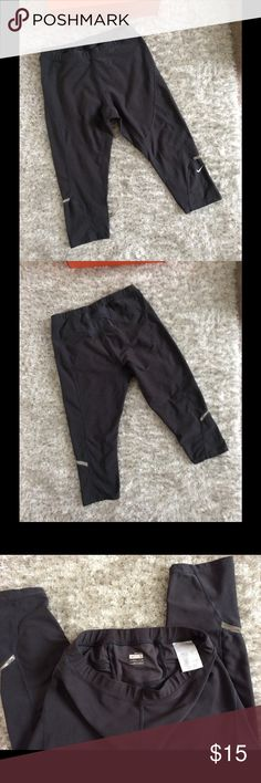 Nike Run Crops Size small. Color is dark gray. 2 back pockets. Waist and inseam measurements pictured.  Reflective material peeling on Left leg, look at pics closely.  This does not affect the integrity of the material.  Overall condition is good. Nike Pants