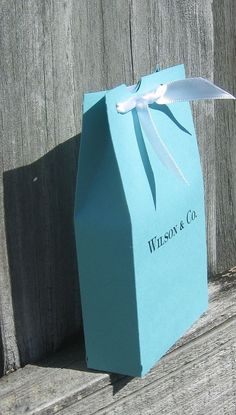 How cute! They personalize the favors so instead of Tiffany & Co, it's the couple's last name & Co!