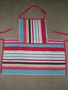 Make an easy apron for your kids. Use an kitchen towel and a dish cloth and some ribbon. Easy.