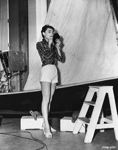 Audrey Hepburn touches up her make-up off the set of 'Sabrina.' via StyleList