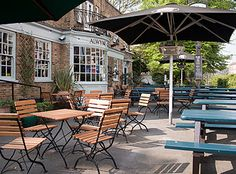 One of the best pubs near my house- the Alwyne Castle in Highbury. Snuggle up with a large glass of wine in front of a fire, or get involved with the Tuesday night quiz while enjoying a plate of their amazing skin-on chips. (Not for sharing! Garden Furniture, Outdoor Furniture Sets, Outdoor Decor, Painted Benches, Best Pubs, Beer Garden, Rooftop Bar, London Calling, My House