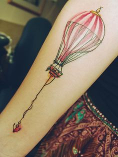 creative hot air balloon with a little anchor watercolor tattoo on forearm