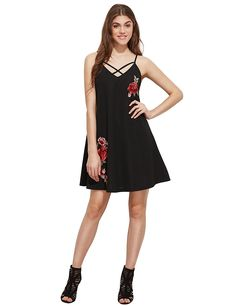 A flirty and breezy embroidered floral dress styled with some trendy crisscross action.
