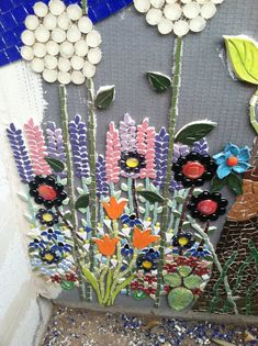 Wall in progress I like how the artist did the agapanthus with glass jewels. Mosaic Garden Art, Mosaic Flower Pots, Mosaic Wall Art, Tile Art, Pebble Mosaic, Mosaic Diy, Mosaic Crafts, Mosaic Projects, Mosaic Glass
