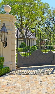 Custom wrought iron entry gate; gorgeous entry! Love everything; definitely doing the cobblestone look