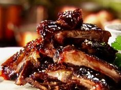 Sweet Sour Short ribs: 6 lbs. beef short ribs 1 cup pineapple juice. 1 cup water. 1 cup soy sauce. 1/2 cup honey. 2 tbsp. minced garlic, 2 tbsp. brown sugar Directions: In sauce pan, combine all ingredients, except beef, stir. Simmer 5 minutes. Pour over beef ribs and refrigerate for several hours.  Place ribs in sauce pan. Pour marinating sauce over ribs; cover. Cook over medium heat until boiling then turn heat to low and cook for 1 1/2 hour. Optional: Add pineapple chunks to sauce.