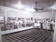 nterior of Carl's Bakery, 710 E. Gadsden St.    Popular bakery in Old East Hill, located at the corner of Gadsden and 8th Avenue. Closed late 1960s or early 1970s. This photo looks like 1930s or 1940s. Now renovated, Strobel & Hunter Architects' office.