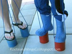 DIY- Aluminum can stilt stompers~ 28oz tin cans  -Nylon cord/rope  -Hammer  -Large nail  -Tape  -Lighter  -Spray paint/ decorations