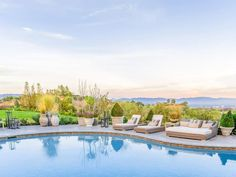Pin for Later: J Lo Just Took a Drastic Step to Sell Her Outrageously Decked-Out Mansion  From its high vantage point, the home offers dramatic views of the San Fernando Valley city lights and San Gabriel Mountains.
