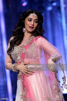 Indian Bollywood film actress Madhuri Dixit, as a judge, performs during the grand finale of the television dance reality show 'Jhalak Dikhhla Jaa Season 7' in Mumbai on September 18, 2014.