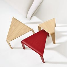 Spanish studio Lievore Altherr Molina has designed a family of triangular tables and stools for Italian brand Arper