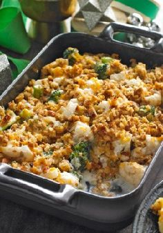 Stuffing-Topped Vegetable Bake — Broccoli and cauliflower florets in a cheesy, garlicky sauce taste even better topped with flavorful stuffing in this family-pleasing vegetable bake.