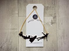 Peter Pan Necklace via House Of Wonderland. Click on the image to see more!