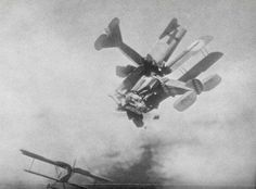 A British 'Bristol' and a German 'Fokker' collide in mid-air during a dogfight, World War I.