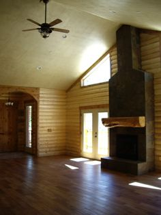 High ceilings and wood paneling turned out looking great for this cabin. Click for more pictures.