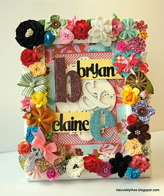 An altered frame with loads of Maya Road blossoms and trinket pins. LOVE!