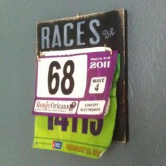 Race bib holder...LOVE...I don't know what to do with all my bibs, but I want to keep them!