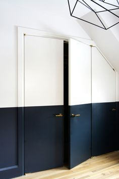 Half painted wall, painted door - black and white interior