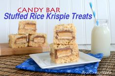 as if Rice Krispie treats were not full of sugar as is let's go ahead and stuff it with some MORE sugar!  ha!   Candy Bar Stuffed Rice Krispie Treats