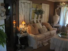 Shabby Chic Living Room...three doors and a window frame create a sofa backdrop..hope the stockings were there for the holidays!