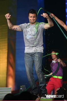 Host Jaime Camil speaks onstage after getting slimed during the Kids Choice Awards Mexico 2013 at Pepsi Center WTC on August 31, 2013 in Mexico City, Mexico.  (Photo by Victor Chavez/WireImage)