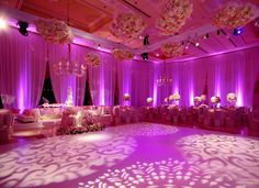 4 gobo projectors and 9 uplights create this amazing look! #gobo #uplighting #rentmywedding #rentmywedding.com
