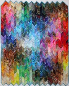 """"""" Diamonds are Forever"""", a colorwash quilt seen at Block Watchers.  This quilt is designed to be made as a scrap or charm quilt."""