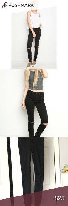 Brandy Melville black jeans Black high rise skinny jeans from Brandy Melville. Ripped knees. Size 26, waist stresses. Never been worn. Brandy Melville Jeans Skinny