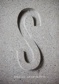 Concrete signage - SKHY Apartments by Leah Shao.
