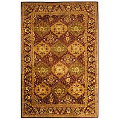 Handmade Tabriz Wine Wool Rug (6' x 9') Overstock.com $246.19  Area rug is hand-spun with dense wool pile Highlighted in shades of green, gold, ivory, red and rose Made utilizing ancient pot-dying techniques Cotton backing and a fringleses border Offers warmth and uniqueness to be enjoyed for years to come Primary Color: Red Pattern: Oriental Measures 0.625 inch thick 100% wool