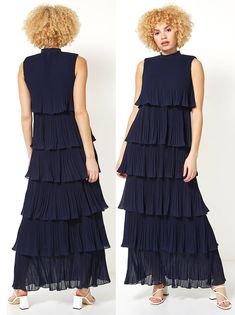 Navy Pleated Chiffon Maxi Dress. What to wear for a Winter Wedding. Make a style statement at your next event in this dramatic, floor sweeping maxi dress. Crafted from a luxurious pleated chiffon, this high-neck maxi dress is layered to create frills and movement as you twirl across the dance floor. Perfect for race-days and Weddings, this sleeveless dress fastens with a concealed zip at the back and looks great with matching jacket and fascinator. #pleateddress #weddingguest #fashion #ootd Christmas Wedding Outfits, Winter Wedding Guests, Chiffon Maxi Dress, Winter Fashion Outfits, Formal Wear, Fascinator, What To Wear, Ootd, Floor