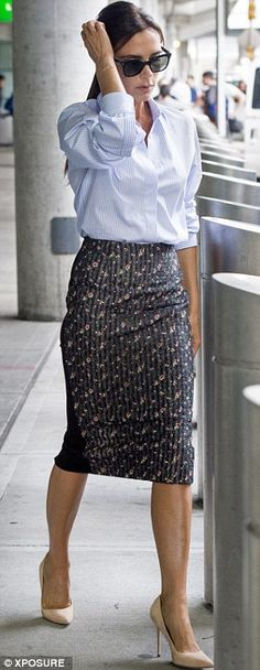 Victoria Beckham stuns in slinky corporate attire as she jets into JFK #dailymail