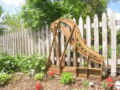 The harp from a repurposed  baby grand piano has been moved to the garden - an interesting, lovely sculptural piece!~