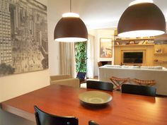 """Table splitting room and kitchen, and sofa as the end of a """"room"""""""