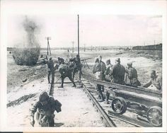 Soviet soldiers fixing rail line under direct fire of Germany artillery (1943), pin by Paolo Marzioli