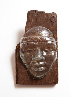 Máscara de índio em vidro , com madeira de demolição. By Jacyra. https://www.facebook.com/JacyraPerimArtes