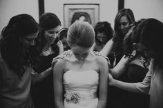 Pre-ceremony prayer with the bridal party | Photo by Aaron & Whitney Photography