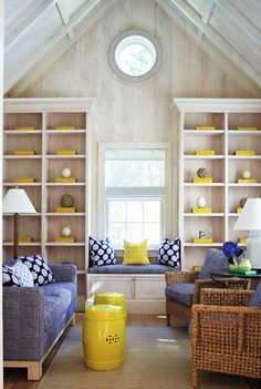 Love the textured chairs, navy prints, and pops of yellow. Such a cheery room