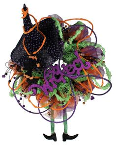 """Cosmic Twist Halloween work wreath: velvet roping, cotton candy roping, glamour rope, witch legs & hat, the word """"wicked"""" and our open netting fabric."""