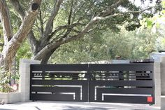 Automatic ornamental iron driveway gates - contemporary - entry ...