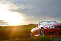 BMW Z4, carbio, mountains, topdown, driving, fun, rocks, blue sky.