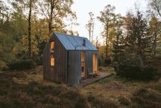 Scottish architect Iain MacLeod and artist Bobby Niven conceived the bothy seen here as a diminutive live-work space for artist residencies. This one sits on the banks of the River Spey, in a wooded area of the Cairngorms National Park near Aviemore.