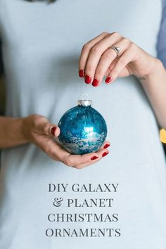 DIY Galaxy and Planet Christmas Ornaments - Have fun making these holiday crafts for your own tree or as a gift idea. The technique is easy enough for a beginner, and every Christmas ball decoration is one of a kind! This would fit with an outer space or science theme but would go equally well as just a pretty swirled, marbled decor design!