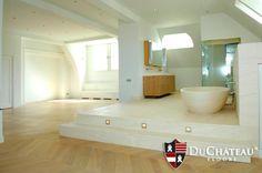 Wood floors in the bathroom. DuChateau Floors New Classics Parquet hardwood flooring.