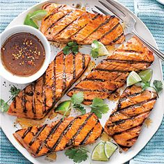 Firecracker Grilled Salmon | MyRecipes.com 6 (6-oz.) salmon fillets 1/2 cup vegetable oil 1/4 cup reduced-sodium soy sauce 1/4 cup balsamic vinegar 1 tablespoon honey 2 teaspoons finely chopped garlic 2 teaspoons dried crushed red pepper 1 1/2 teaspoons ground ginger 1 teaspoon sesame oil 1/2 teaspoon table salt 1/4 teaspoon onion powder
