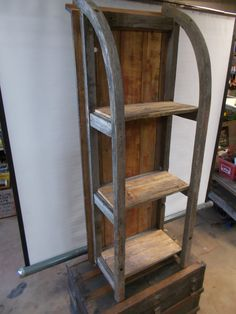 Old sled repurposed in to a coffee table or can be stood up to use as shelving.